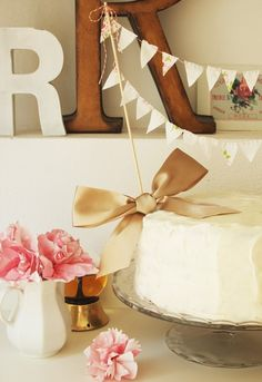 Taupe bow and bunting cake topper. Adorable!