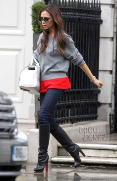victoria beckham wears a red and gray sweater and louboutin boots while out in london