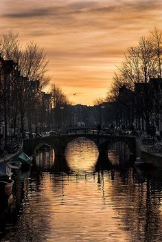 Sunset over a canal in Amsterdam, The Netherlands (by jaccobmckay) #Holland #travel #Amsterdam
