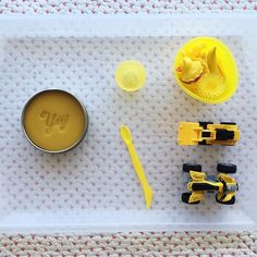 A little yellow themed invitation to play, with @z_dough citrus scented play dough - its the first time we've tried this and our favourite dough so far, julia was obsessed with the smell too - great for strengthening hand muscles and coordination, and creative play - its probably the activity where julia will be stay engaged for the longest.