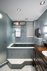 The multifaceted design of this master bath by Alan Berman references the historical nature of the building, as well as the family history of the owner.