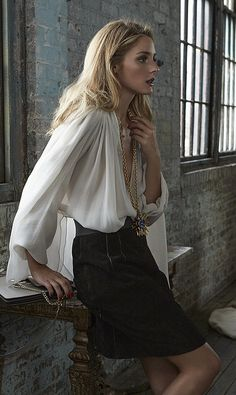 Olivia Palermo wearing a Lanvin shirt, Oscar de la Renta pendant, Dolce & Gabbana skirt, and Chloé bag.