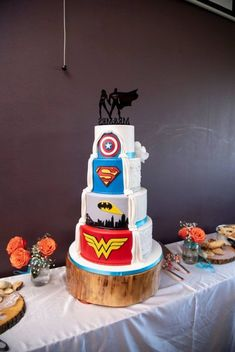 Michael and Meredith s wedding in St Catharines Ontario - Batman Wedding - Ideas of Batman Wedding - Superhero wedding cake with cartoon illustrations AMV Weddings Marvel Wedding Theme, Superhero Wedding Cake, Batman Wedding Cakes, Avengers Wedding, Comic Book Wedding, Themed Wedding Cakes, Superhero Cake, Fall Wedding Cakes, Wedding Cake Designs