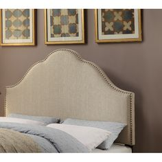 Shop Joss & Main for your Giada Upholstered Headboard in Beige. Anchor an elegant master suite or guest room ensemble with this chic headboard, showcasing a scalloped silhouette and nailhead trim.