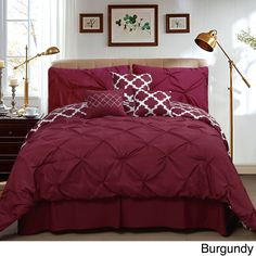 Give your bed a whole new style with this beautiful seven-piece comforter set, complete with a comforter, shams, accent pillows, and a bed skirt. The reversible comforter features a classy solid-color