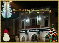 Christmas lights displayed outside within the town of Honiton