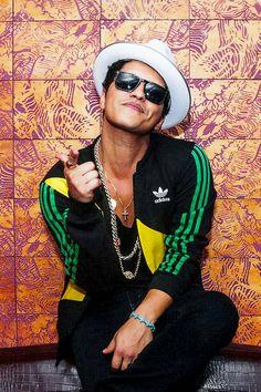 Bruno Mars has that tight bony face that makes me cringe