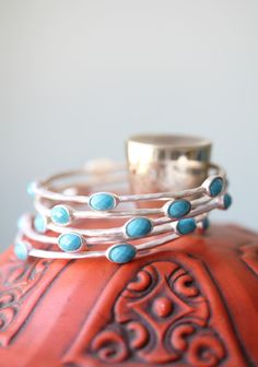 "Spirit Guide Bangle Set 14.99 at shopruche.com. Perfect to mix and match, this set of four silver colored bracelets feature sky blue faceted stones.Approx. 2.5"" in diameter"