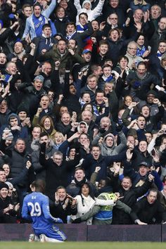 The joy of being a Chelsea fan as striker Demba Ba celebrates after scoring against Manchester United during FA Cup quarter-final replay match at Stamford Bridge - 01 Apr 2013  REUTERS/StefanWermuth.