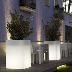 High Cube Illuminated Outdoor Planter - This illuminated outdoor planter is available with LED lighting in multiple colors or a style with a fluorescent bulb that displays only white light.