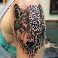 Realistic looking colored shoulder tattoo of wolf head with ornamental mask