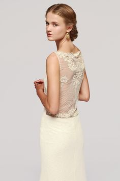 PIAF is just such a stunning wedding dress. The transparency in the back with flower motives and delicate front with diagonal line dropping is one of the finest models in the collection. Sleeveless, this unique wedding gown drops elegantly to the ground with a bit of a tail and gives a delicate touch to the bride aside from the glamour of the spectacular look.