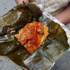 Guatemalan Tamales with Ancho Chile Sauce Recipe   SAVEUR. Ingredients: canola oil; 1  1-lb. piece boneless pork shoulder; Kosher salt; plum tomatoes; garlic; ancho chiles; small white onion; distilled white vinegar; sugar; fresh or frozen and thawed banana leaf; achiote paste (ground annatto seed and spices); optional — masa harina (corn flour for tamales; preferably Maseca brand); rice flour; capers; large pitted green olives; red bell pepper.
