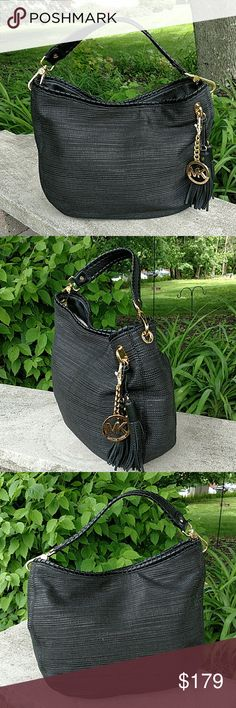 """NWT!  Michael Kors Bennet Straw Large Hobo Exterior features soft straw w/leather trim.  Detachable leather shoulder strap w/whipped stitch detail - 7"""" drop.  Removable MK logo charm and tassels.  Goldtone hardware.  Interior features logo jacquard lining w/one inside zip and two slip pockets one side; two slip pockets on opposite side.  Magnetic snap closure.  Spot clean only. Michael Kors Bags Hobos"""