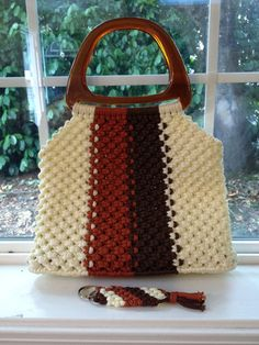 Nothing says 1970s like a Macrame Purse with Matching Key Chain! Vintage bag in cream, burnt sienna, and dark brown synthetic cording. Has