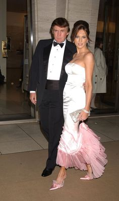 Melania's boudoir look was complete with a pink ruffled trim and matching shoes at the 2003 American Ballet opening at Lincoln Center in New York. Milania Trump Style, Donald Trump Family, Famous Wedding Dresses, Trump Picture, First Lady Melania Trump, Melania Trump Young, Donald And Melania, Trump Is My President, Mother Of The Bride