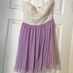 White lace dress with purple skirt White lace on top with built in bra, beautiful purple on bottom. Small but can fit a small or medium a'gaci Dresses Mini