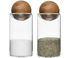 """Salt & Pepper set features oak stoppers to keep salt & pepper dry. - Material: Oak/Glass - Size: Dia. 2"""", H 4 ½"""" Please allow 1 - 2 weeks to ship out and receive tracking."""