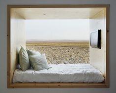 full window view outside from bed, put drawers underneath on raised platform