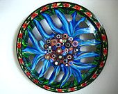 from my pal, sharon zigrossi. her blooming hubcaps