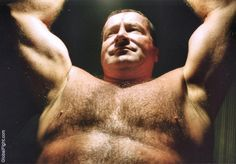 man arms up workout