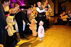 10 New Twists on Old Wedding Traditions - Candy Toss to kids instead of a garter toss.