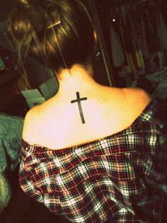 cross tattoo. back tattoo. placement. this is me (: