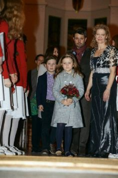 (left back to right) Denmark's Crown Princess Mary, Crown Prince Frederik, Prince Christian and Princess Isabella attending a Christmas concert in the Esayas church, 15.12.13