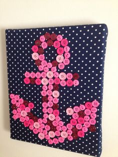 anchor craft ~  sororitycraft:    I covered a thick canvas with fabric and glued the buttons on with hot glue. You could sew them, but it would take much longer. I've also seen this hung with a ribbon, and I've seen them where each letter is on a different canvas and they're hung together.