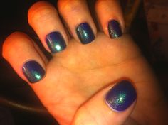 Did my nails today! I layered Sinful Colors Dream on ( a bright florescent matte purple) with Sinful Colors Kissy (a bright blue glitter polish) on top. Turned out really pretty when it moves in the light!