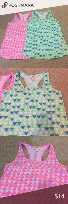 Set of 2 Mossimo tank tops 2 tribal print Mossimo racer back tanks - pink/orange and green/blue. Excellent condition. Size small. Mossimo Supply Co Tops Tank Tops