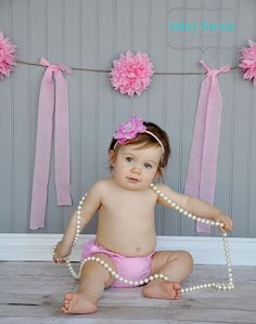 First birthday session. Baby girl with pearls. Grey and pink