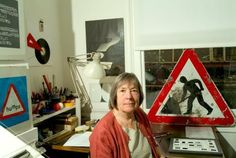 Margaret Calvert (born 1936) is a typographer and graphic designer who, with colleague Jock Kinneir, designed many of the road signs used throughout the United Kingdom, as well as the Transport font used on road signs and the Rail Alphabet font used on the British railway system and an early version of the signs used in airports.