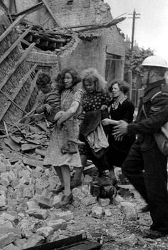 This Air Raid Warden assists a London family that survived a Lufwaffe raid during WWII