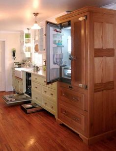 What appears to be a restored, vintage icebox is actually a three-sided cabinet of oak paneling built by the homeowner to conceal a modern refrigerator. The dishwasher, too, is hidden in cabinets. Photo by Bill Ticinito.