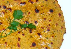 <p>This is a high-protein roti because I mixed up garbanzo bean flour, or besan, and whole-wheat flour to make the roti dough. I also threw in handfuls of mint, sage, and thyme, all finely chopped, along with some spices.</p>