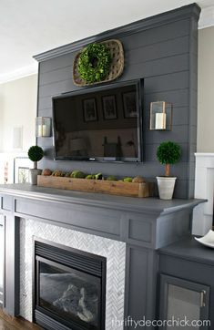 Gray fireplace with marble surround - love the tobacco basket with wreath inside