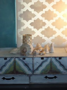 I think this is actually a stenciled roller shade-- beautiful. Love the Gold and White! Well done...