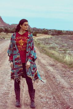 Inspired by American Navajo textiles and colors of the New Mexican desert, our open-front poncho gets attention to detail with frayed edges, concho button, and a braided suede tassel closure. It is perfect for throwing over your favorite tee and jeans. • open-front poncho • concho button with braided suede tassel closure • frayed fringe • 100% cotton • July Delivery / 2017 Trans-Season / Abiquiu