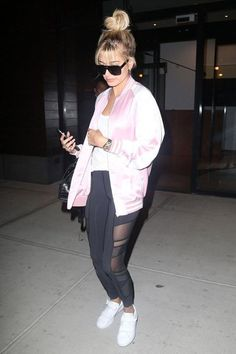 Hailey Baldwin wearing Saint Laurent Cabas Rive Gauche Croc Embossed Bag, Saint Laurent Teddy Two-Tone Bomber Jacket, Acne Triple Strap Grip Tape Leather Sneakers, Saint Laurent Sl 87 Sunglasses and Lululemon Just Breathe Mesh Leggings
