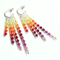 Rainbow from light yellow to light pink.  Made of Swarovski sparkling crystals.