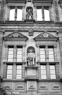 Windows and statues on the facade of the Ottheinrichsbau at Heidelberg Castle in Germany