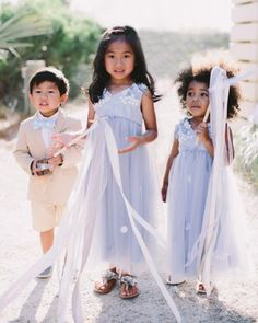 Flower girls Skyla and Lalani wore dresses from Monsoon and carried ribbon wands, crafted by wedding planner Eva Clark of Belle of the Ball Events.