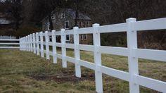 3-Rail Ranch Vinyl Rail Fence surrounds this local horse farm...