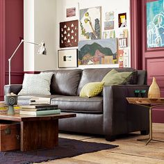 Just like my sofa. Good ideas for living room coffee table and art layout.