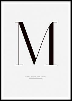 Stilren tavla med typografi. Bokstavstavla med M. Grafiska tavlor och posters med bokstäver.