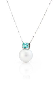 18kr white gold pendant set with Paraiba Tourmalines with under it a 15mm large light blue overtone South Sea Pearl from Australia from the Daniel Moesker Pearls Collection