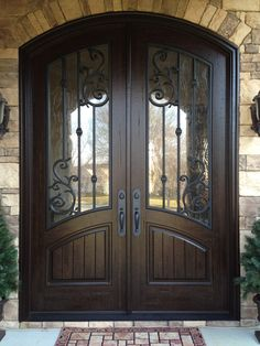 Looks like the door is frowning. Double Front Entry Doors - Orleans Panel Design - Finished in Rustic Distressed Walnut. 678-894-1450 www.masterpiecedoors.com