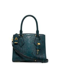 Exotic python elevates our Casey satchel, making it the epitome of everyday opulence. This polished piece boasts ample interior compartments, but in a scaled-down design that's perfect for day or night. We especially love it styled with a super-sleek little black dress for a glamorous after-dark look.