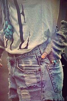 Love the ripped jeans and white tshirt.  The Fingerless knit gloves. love em...